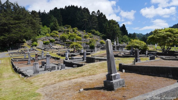 The cemetery is odd, placed on a hillside with many crypts that are now sealed in concrete.