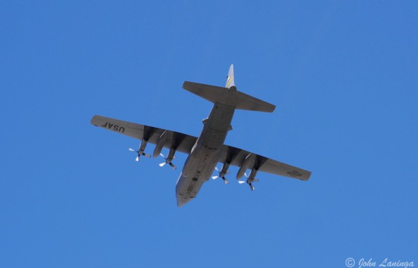A C130 doing touch and goes at F E Warren AFB