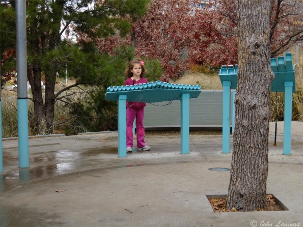 Outside, a xylophone gets the attention of a young girl