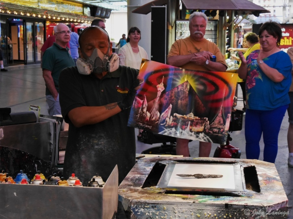 Craftsman showing spray paint paintings