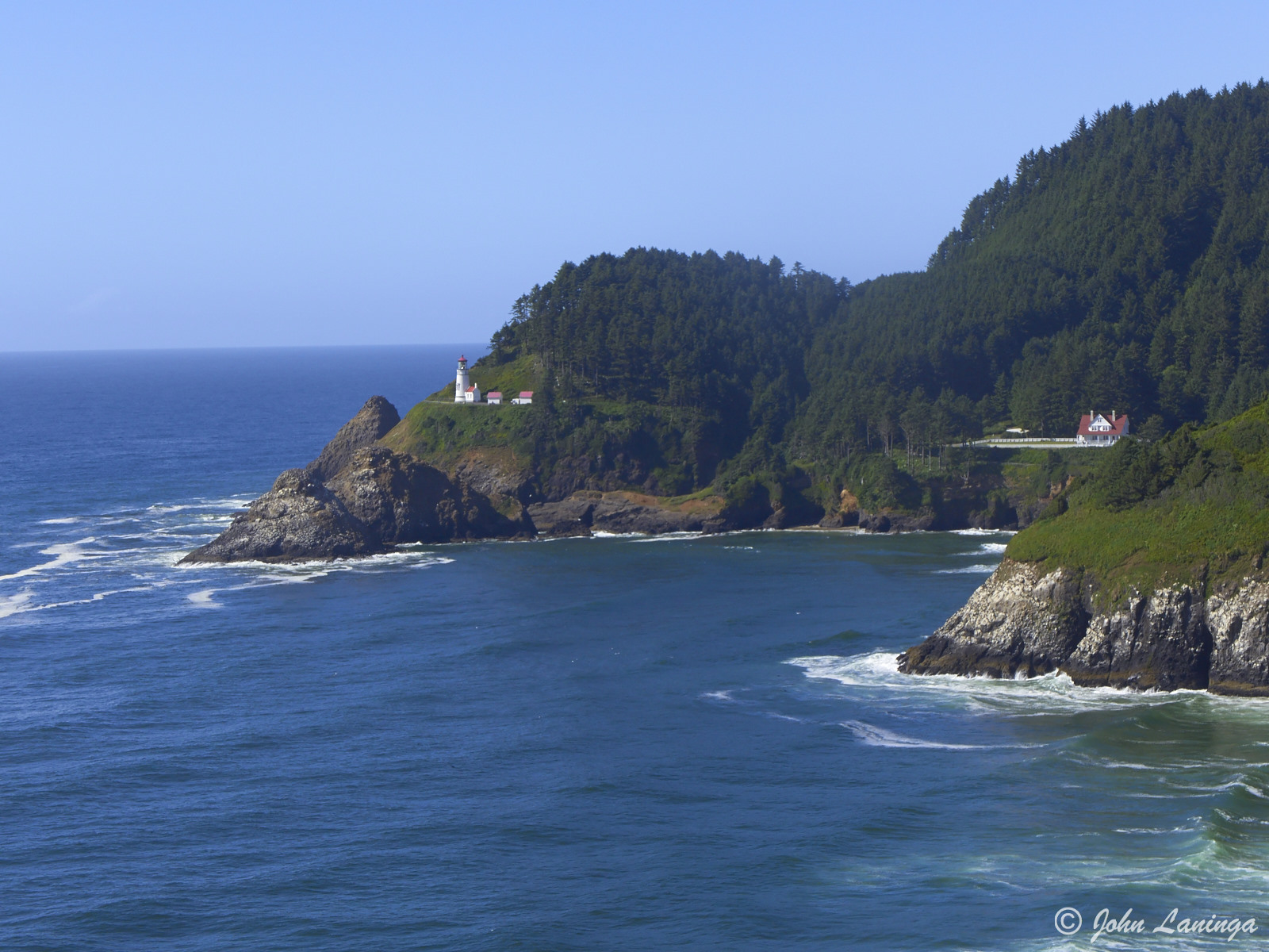 Distan view of Heceta Head lighthouse