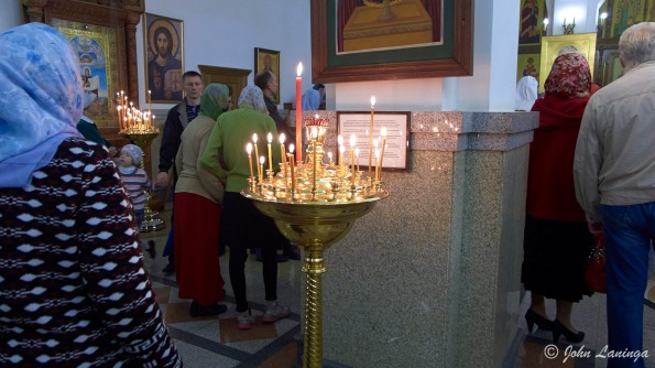 Lighting candles in the church