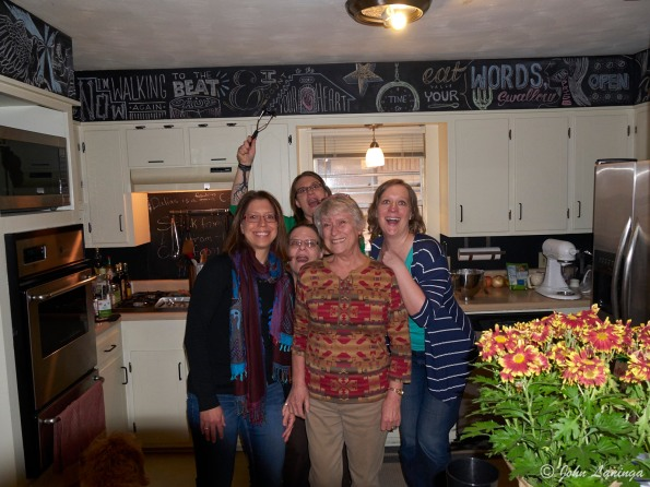 The women hamming it up in the kitchen