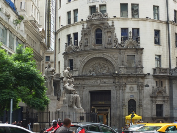 Statue with building facade