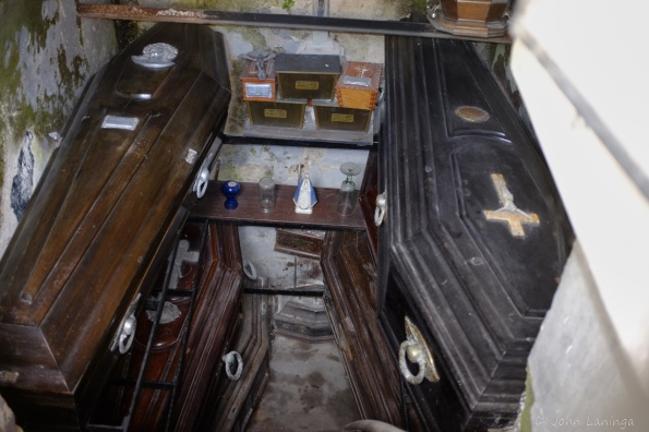 Inside one, caskets stacked on top of each other