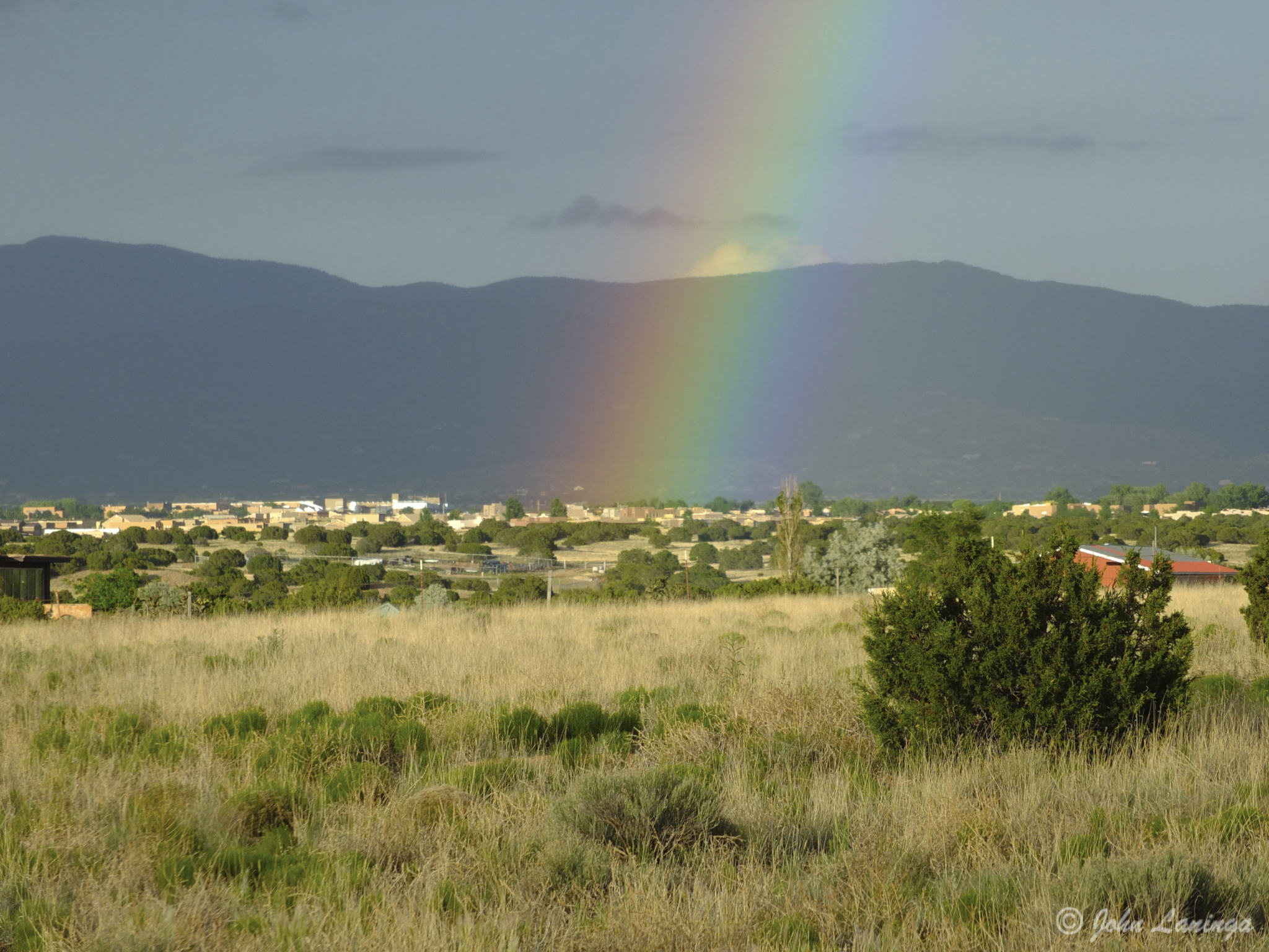 A rainbow over the foothills