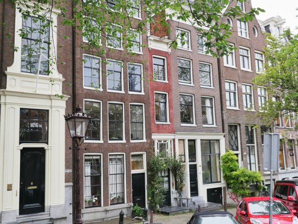 Smallest house in Amsterdam (the red building), 39 inches wide and occupied too!