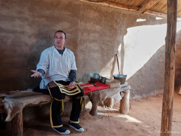 Our  guide, explaining life in an Cherokee house